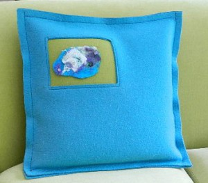 Felted pillow of industrial felt. Insert is felted merino wool.