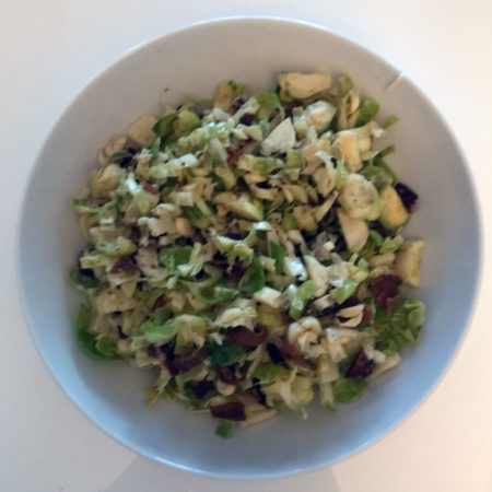 Brussels sprout salad with bacon, manchego cheese and pecans