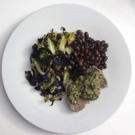 Pork tenderloin chimichurri with black soy beans and roasted brussels